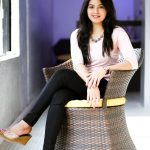 Amritha Aiyer, rose colour dress, chair, sit