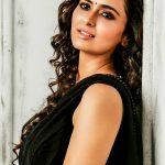 Meenakshi Dixit, black saree, glamour