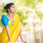 Niranjani Ahathian (14) yellow saree big necklace model pose