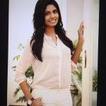 Niranjani Ahathian (34) white shirt pant pose