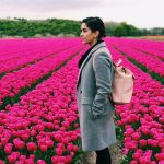 sanya malhotra  pink rose garden background pic. tulips garden with grey overcoat(24)