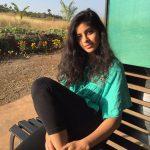 Anisha Victor, green dress, hair style