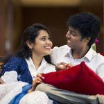 Atlee Kumar , Krishna Priya, couple, sitting