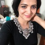 Dhivyadharshini, black dress