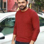 Ezhumin Movie Trailer Launch, Karthi, Red T Shirt