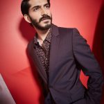Harshavardhan kapoor brown overcoat designer shirt and red background(15)