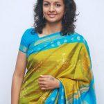 Kiruthiga Udhayanidhi, bluse saree, smile