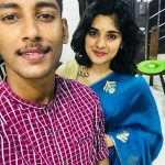 Nivetha Thomas, with brother, thambi, saree