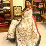 bhavana white saree pose in shop(15)