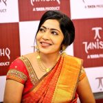 ramya vj candid pic at opening of tanishq showroom red and golden saree traditional look jewellery