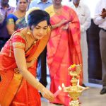 ramya vj candid pic at opening of tanishq showroom red and golden saree traditional look jewellery kuthuvilakku 2