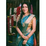 ramya vj in blue silk saree golden blouse and gold jewellery traditional look