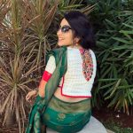 ramya vj in green silk saree with colored blouse in garden