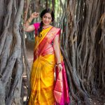 ramya vj in yellow silk saree flowers traditional look pose with pink blouses banyan tree