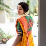 ramya vj in yellow silk saree jasmine flowers traditional look back pose with green blouse