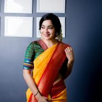 ramya vj in yellow silk saree jasmine flowers traditional look front pose with green blouse