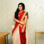 ramya vj white and red half saree with green blouse