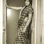 ramya vj with checked saree jasmine flowers and jewellery black and white pic