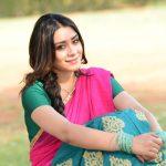 Anchal Singh, pink half saree, siting