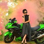 Anikha Surendran, Baby Anika, 2018, Black dress, Green bike
