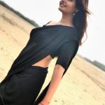 Ashima Narwal, black saree, hip, side view