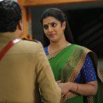 Kaatteri, green saree, Varalaxmi Sarathkumar