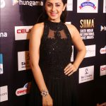 Nikki Galrani, black dress, function