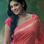 Veena Nandakumar, red saree, favorable
