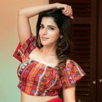 Iswarya Menon, hands up, hip, camera look