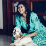 Kalyani Priyadarshan, pet, dog, playing