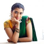 Lovelyn Chandrasekhar, green half saree