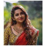 Nakshathra, red saree, brown hair