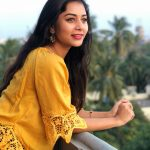 Suza Kumar, face, casual, yellow dress