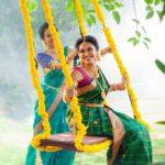 Indhuja, green saree, unjal, playing