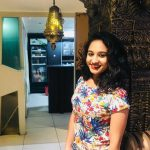 Pooja Ramachandran, mall, curly hair