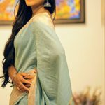 Neethu Vasudevan, blue saree, yellow light, side pose