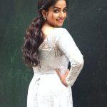 Nithya Ram, Asathal Chutties, white dress, back side