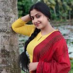 Anu Sithara, Podhu Nalan Karudhi Actress, yellow dress