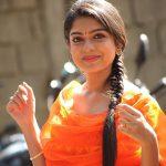 Varsha Bollamma, Mandharam heroine, orange dress