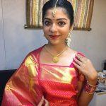 Varsha Bollamma, Mandharam heroine, red saree, trendy