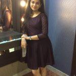 Anitha Sampath, former news anchor, modern dress, black dress