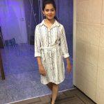 Anitha Sampath, voice over artist, white dress, sun tv
