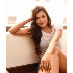 Ashna Zaveri, sitting, smile