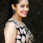 Chaya Singh, side pose, smile