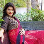 Anjena Kirti, RK Nagar, pink saree, street