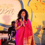 Maalavika Sundar, singing, red saree, curly hair