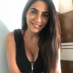 Nikki Tamboli, Dharma Prabu Actress, smile, loose hair, pretty