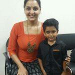 Manju Warrier, Asuran Heroine, orange dress, kid