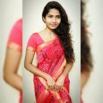 Venba, red saree, loose hair
