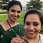 Indhuja Ravichandran, charming, grass, green saree